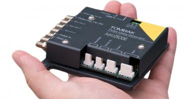 A hand with the digital delay generator